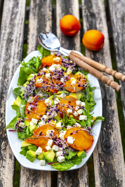 Green salad with fried apricots, avocado, feta cheese and radish sprouts - SARF03868