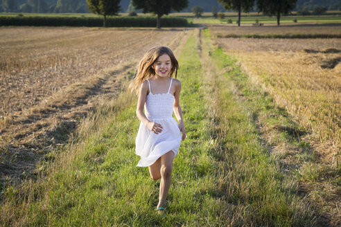 Happy little girl running in nature - LVF07356