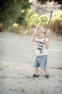 Young male toddler with stick - ISF19393