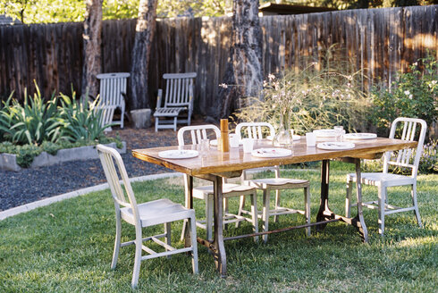 A table in a garden laid for a meal. - MINF03239