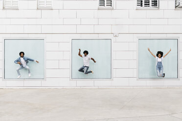 Three friends jumping together in the air - JRFF01761