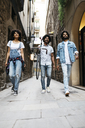 Spain, Barcelona, three friends walking in the city - JRFF01767