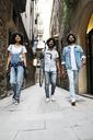 Spain, Barcelona, three friends walking in the city - JRFF01767
