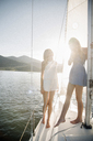 Portrait of two blond sisters on a sail boat. - MINF03882