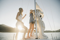 Portrait of two blond sisters on a sail boat. - MINF03891