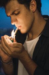 Young man smoking a joint - KKAF01339