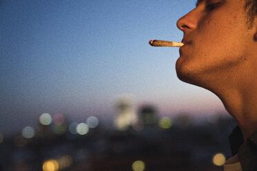 Young man smoking a joint - KKAF01342