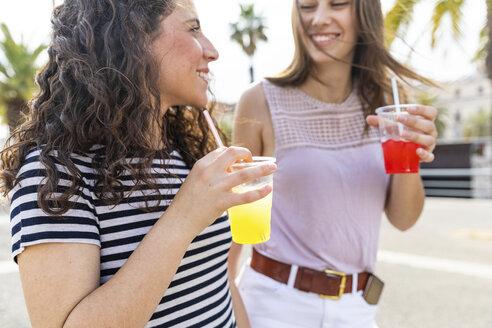 Two happy female friends enjoying a fresh slush - WPEF00767