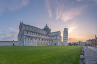 Italy, Tuscany, Pisa, View to Pisa Cathedral and Leaning Tower of Pisa from Piazza dei Miracoli at sunset - RPSF00233