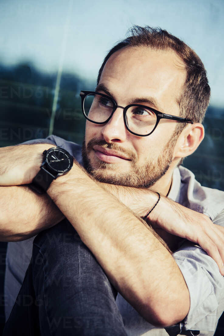 Portrait of bearded man wearing glasses and writs watch - NGF00463 - Nadine Ginzel/Westend61