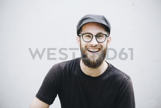Portrait of laughing man dressed in black - NGF00466