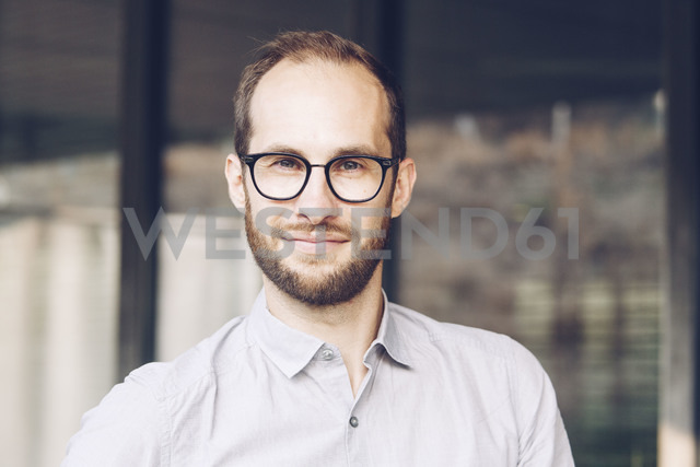 Portrait of bearded businessman wearing glasses - NGF00478