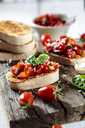 Italian buschetta on chopping board - SBDF03719