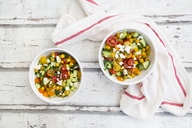 Bowl of salad with chick peas roasted with curcuma, feta, cucumber, tomatoes and parsley - LVF07367