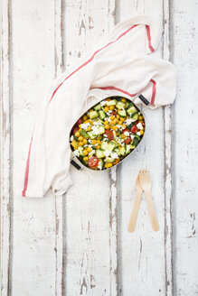 Lunch box of salad with chick peas roasted with curcuma, feta, cucumber, tomatoes and parsley - LVF07370