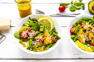 Lamb's lettuce with colorful tomato, avocado, parmesan and curcuma lemon dressing - SARF03877