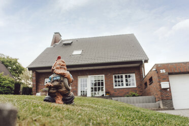 Garden gnome in garden of one-family house - JOSF02535