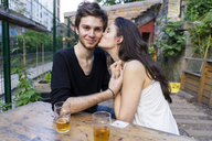 Portrait of young couple at an outdoor bar - AFVF01229