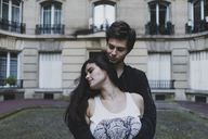 France, Paris, Montmartre, young couple in love in front of building - AFVF01241