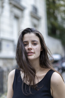 Portrait of beautiful young woman in the city - AFVF01247