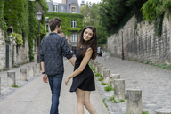 France, Paris, young couple in an alley in the district Montmartre - AFVF01253