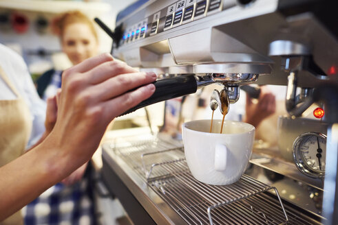 Close-up of barista making coffee at a cafe - ABIF00850