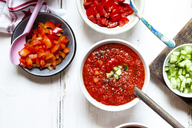 Bowl of Gazpacho with cucumber and bell pepper topping - SBDF03726