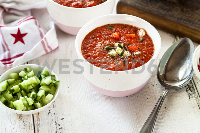 Bowl of Gazpacho with cucumber and bell pepper topping - SBDF03729