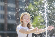 Young woman with hat at fountain - SGF02207