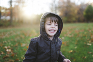A child, boy playing in the park surrounded by autumn leaves. - MINF05063