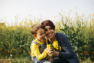 Portrait of happy mother with little son in nature - JRFF01789