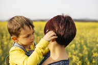 Little boy and his mother in a rape field - JRFF01795