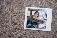 Instant photo of young woman in a van - KKAF01399