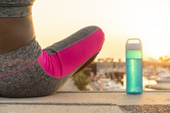 Young sportive woman during workout, water bottle - AFVF01271