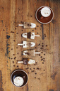 Homemade Espresso Macchiato and Latte Macchiato ice lollies with coffee beans on wooden background - GWF05630