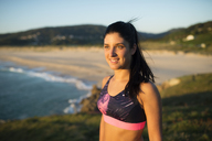 Portrait of an athlete woman in the evening, beach in the background - RAEF02066