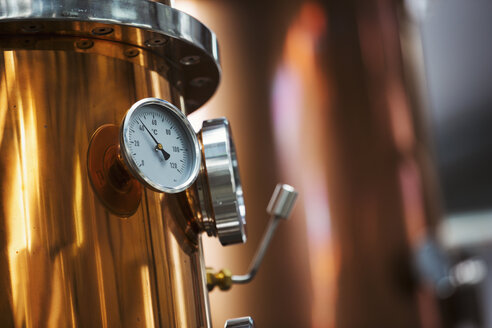 Close up of a gauge on a copper brew kettle or fermentation chamber. - MINF05524