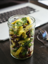 Jar of three bean salad on office desk - HAWF01015