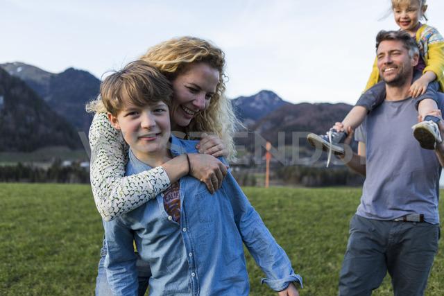 Austria, Tyrol, Walchsee, happy family hiking on an alpine meadow - JLOF00217