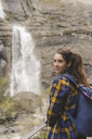 Spain, Ordesa y Monte Perdido National Park, portrait of smiling young woman with backpack - AFVF01288