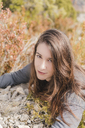 Portrait of smiling young woman in nature - AFVF01306