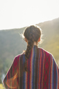 Spain, Alquezar, back view of woman with braid at backlight - AFVF01309
