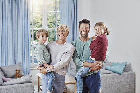 Portrait of happy family with two kids at home - RORF01382