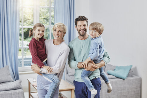 Portrait of happy family with two kids at home - RORF01385