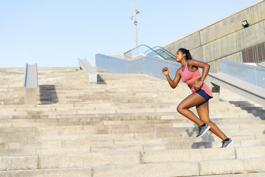 Young woman during workout on stairs - AFVF01325