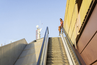 Young sportive woman on escalator - AFVF01328