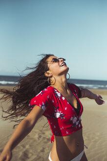 Teenage girl having fun on the beach - ACPF00157