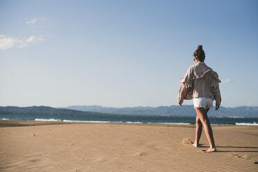 Back view of teenage girl walking on the beach - ACPF00163