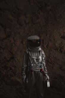 Spaceman exploring nameless planet, holding torch - VPIF00454