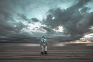 Lonely spaceman looking at lake on nameless planet - VPIF00460
